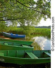 boats on the lake shore