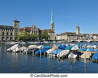 Boats on the Limmat and Fraumuenster, scene in Zurich