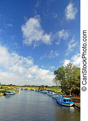 Typical scene of Boats berthed on the Norfolk Broads, England