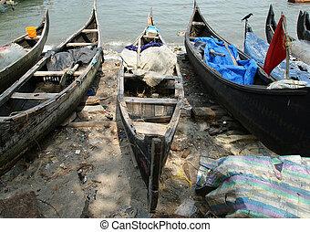 boats on the ocean shore. Kerala, India