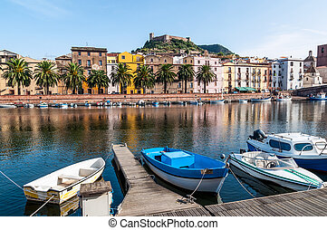 Boats on the river in Bosa in Sardinia - Fishing boats on...