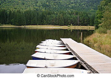 boats on the saint ana volcanic lake, romania