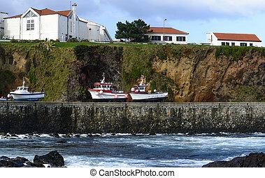 Boats on the shore at Santa Cruz, Azores archipelago...
