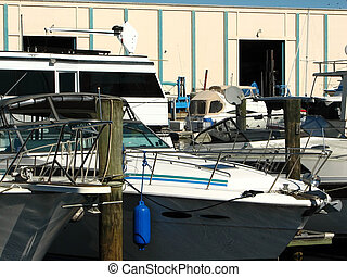 Boats - Shot of a few boats tied down to the dock in a...