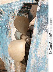 Boat\\\'s propeller - The propeller on a battered fibreglass...