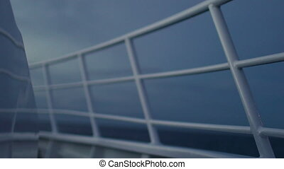 Boat's railings shot - A medium shot of a boat's railings at...