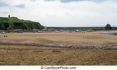 boats resting on the beach at Bude