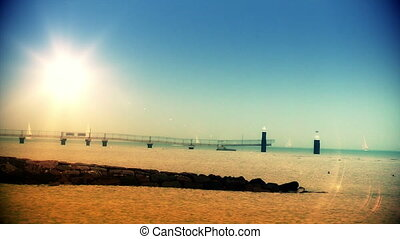 Boats sailing and pier at sunset