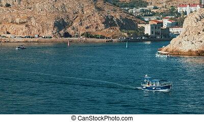 Boats sailing on the sea. Timelapse. Balaclava. Crimea