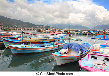 boats stand at the pier in Alanya