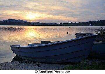 Boats at a lake in the alps of the Allgaeu (Bavaria,...