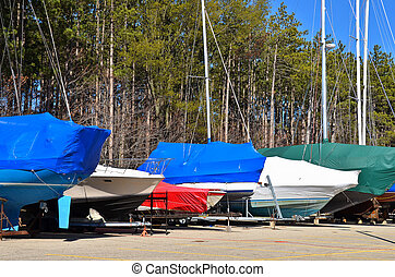 boats under cover - Power and sail boats with protective...
