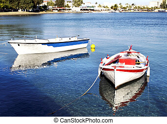 boats with water reflections