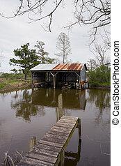 Boatshed on Muddy Bayou - old boatshed on muddy bayou in the...