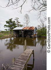 Boatshed on Muddy Bayou - old boatshed on muddy bayou in the...