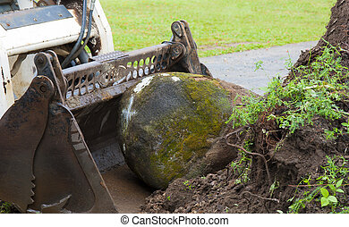 bob cat stone - a bob cat moving a large garden rock