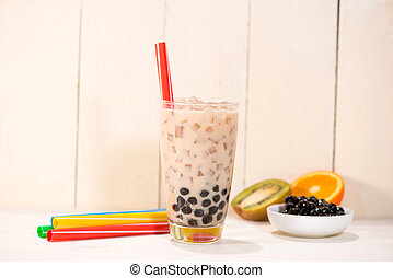 Boba / Bubble tea. Homemade Milk Tea with Pearls on wooden table.