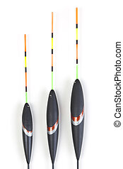 Bobbers - Image of fishing bobbers on reflective surface