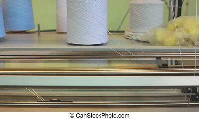 Bobbin runs on working weaving loom, close-up