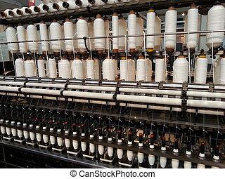 Bobbin thread cones on a warping machine in a textile mill