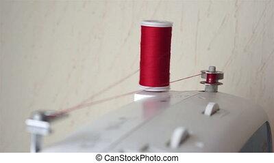 Bobbin Winding on a Sewing Machine - Shot of a sewing bobbin...