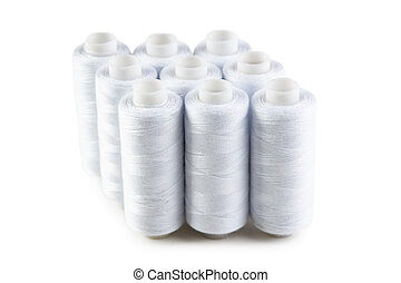 bobbin with white thread isolated on a white background