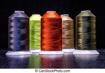 Bobbins of thread on black Background
