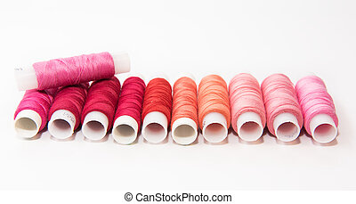 Bobbins of thread on white background