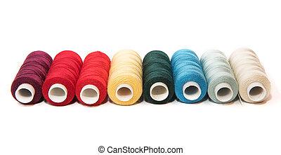 Bobbins of thread on white background