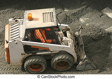 Bobcat scooping up gravel