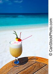 fruity cocktail - Bocal of fruity cocktail on a beach table