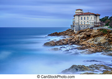 Boccale castle landmark on cliff rock and sea. Tuscany,...