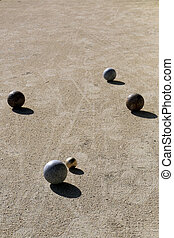 Bocce balls on the sand playing court - Bocce balls around...