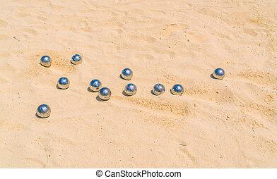 Bocce balls on white sandy beach . - Bocce balls on white...