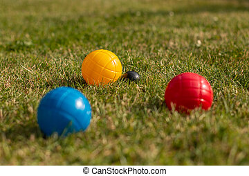 Boccia Balls in primary colors on the lawn