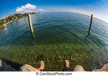 In Meersburg taken with a fisheye the feet of the photographer dangle comfortably from the quay wall.