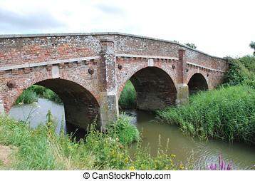 Bodiam bridge, England - The historic road bridge crossing...