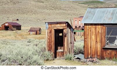 Old open air toilet of the 1800s, in Bodie state historic park, California Ghost Town. In the United States of America, close to Yosemite national park.