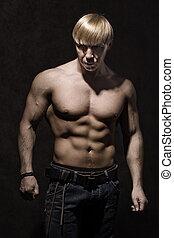 Body Builder - A portrait of a bodybuilder man in a studio.