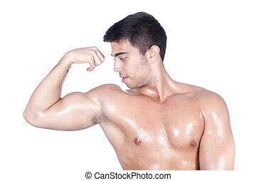 Body builder showing biceps