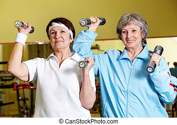 Body building exercises - Portrait of two senior women ...