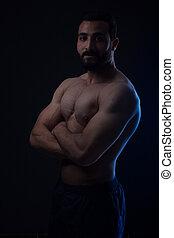 Body building - Smiling body building man - low light