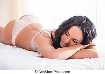 Body care - Attractive young woman is posing in lingerie....