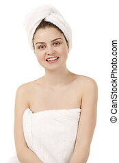 Beautiful young woman posing in white towel