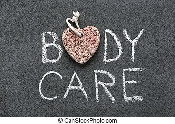 body care phrase handwritten on blackboard with heart symbol...