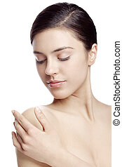 body care - young attractive woman touching her shoulder. ...
