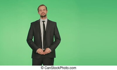 body language. a man in a business suit on a green background