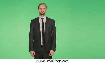 body language. man in business suit . . crossed arms. green...