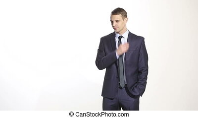 body language. man in business suit isolated on white background. scratching, rubbing the ear. gesture of distrust speaker
