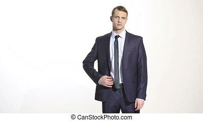 body language. man in business suit isolated white background. Training managers. sales agents. Hands on his belt. a gesture of confidence. aggression